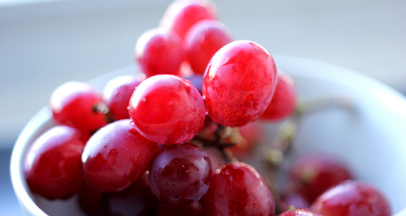 red grapes in a bowl