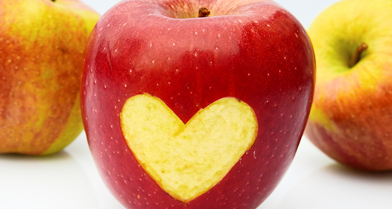 apple with a heart pattern carved in it