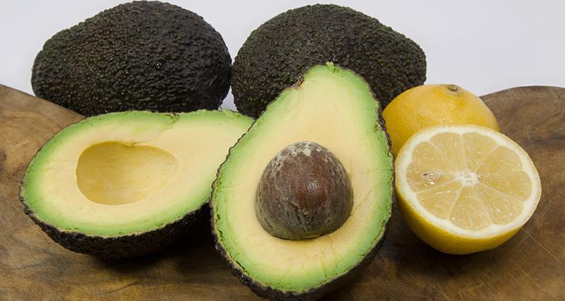 avocado and lemon on a cutting board
