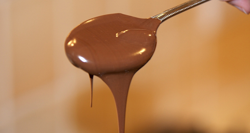 melted chocolate on a spoon
