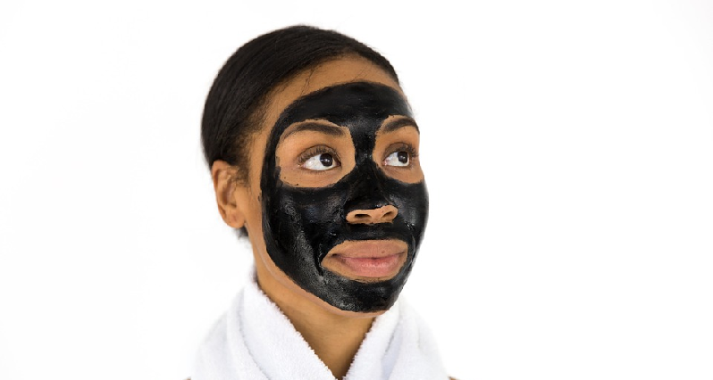 a woman with an activated charcoal mask