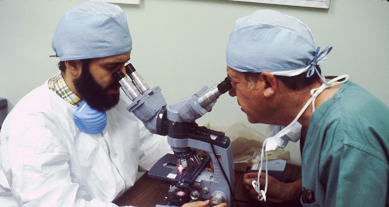 scientists with microscopes