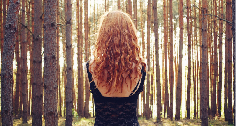 A woman with beautiful hair in the forest